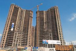 Status report: DLF's Belaire project in Gurgaon. Prospective customers are looking online to check which projects are being delayed. Rajkumar/Mint