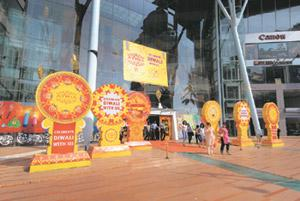 Inviting customers: The scene outside a mall in Mumbai. Abhijit Bhatlekar/Mint