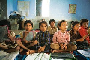 Push for education: Children at a government primary school in Amazir village, Madhya Pradesh. Several states have introduced incentives such as free textbooks and bicycles for girls to go to school t