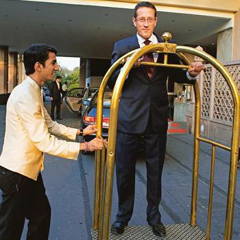 Request granted: Richard Quest (centre) adds 'concierge trolley' to the list of vehicles he has travelled in. Madhu Kapparath / Mint