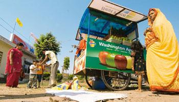 Advertising push: Ranjit Kumar, a juice vendor, with his Bharti Wal-Mart pushcart. Ramesh Pathania/Mint