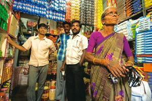 Brand strategy: The owner (extreme right) of a retail outlet in Nellapatla, Warangal, stocks up on Cavinkare's Chik shampoo sachets. Harikrishna Katragadda / Mint