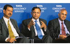 United stand: TCS CEO and managing director N. Chandrasekaran flanked by (left) vice-president and head (global HR) Ajoy Mukherjee and CFO S. Mahalingam at a conference in Mumbai on 16 October. PTI