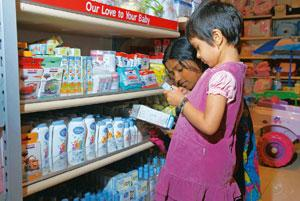 No kidding: A child making her choice from a range of products at a mall in Bangalore. The market is flooded with pencil and lunch boxes, stationery items and school bags emblazoned with cartoon chara