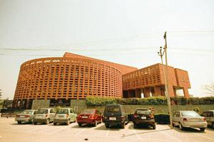 Growth projection: A file photo of Tata Consultancy Services' office in Noida. The information technology firm says it has enough customer contracts to drive revenue gains every quarter for the next t