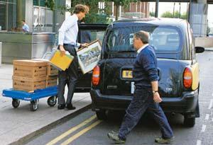 Bitter end: A file photo of a man loading his belongings into a cab after leaving Lehman Brothers' European headquarters in London. Simon Dawson / Bloomberg