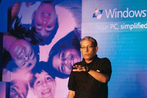 System upgrade: Microsoft India chairman Ravi Venkatesan speaks during the launch of Windows 7 in New Delhi on Thursday. Dar Yasin / AP