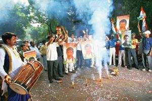 On a roll: Congress workers celebrate the party's wins in the assembly polls in Maharashtra, Haryana and Arunachal Pradesh with fire crackers outside party president Sonia Gandhi's residence in New De