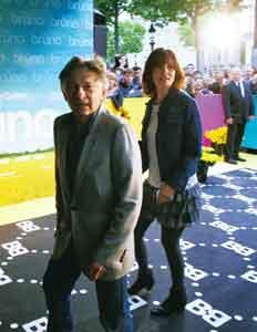 The fallen: Polanski and his wife arrive for a screening in Paris. AFP