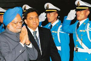 Look east: Prime Minister Manmohan Singh at Hua Hin airport in Cha-am, Thailand, on Friday. PTI