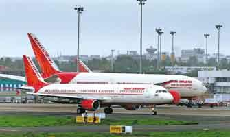 Cash-strapped: Air India aircraft at the Mumbai international airport. The group of ministers will meet again on 30 October to discuss how to infuse funds into Nacil, which operates the national flag