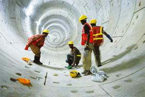 Delhi Metro Rail Corp. workers give the finishing touches to a tunnel between Jangpura and Lajpat Nagar. Ramesh Pathania / Mint