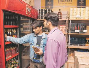 Raising a cheer: A shop selling liquor in New Delhi. Both United Breweries and United Spirits, part of the UB Group, announced their second quarter results on Tuesday. Madhu Kapparath/Mint