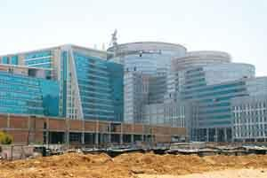 Solid foundation: A commercial complex under construction at DLF Cybercity, Gurgaon. Developers who had shifted focus from commercial projects to residential sales during the slowdown are restarting