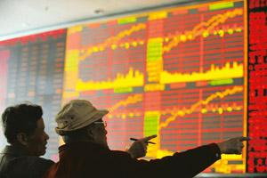 Powering ahead: Investors look at a board showing stock information at a brokerage house in Wuhan, Hubei province. China's key stock index rose 2.7% on Monday, its biggest one-day gain in more than th
