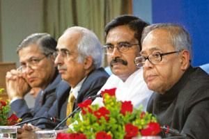 Support stays: (from right) Finance minister Pranab Mukherjee with minister of state for finance S.S. Palanimanickam, finance secretary Ashok Chawla and revenue secretary P.V. Bhide at the economic ed