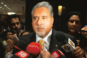 Cost cutting: UB Group chairman Vijay Mallya says Kingfisher Airlines may raise fares to help reduce expenses. Pankaj Nangia / Bloomberg