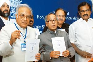 First draft: Union finance minister Pranab Mukherjee with chairman of the empowered committee of state finance ministers Asim Dasgupta at the release of the discussion paper on GST in New Delhi on Tue