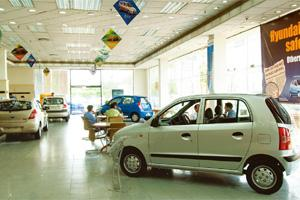 Robust growth: A car showroom in New Delhi. Auto makers sold 132,615 cars in October, compared with 99,052 units sold a year ago, according to Society of Indian Automobile Manufacturers data. Ramesh P