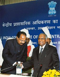 Law and politics: A file photo of Chief Justice K. G. Balakrishnan (right) with Union law minister M. Veerappa Moily. Experts say that a lack of consensus among political parties may hinder the propos