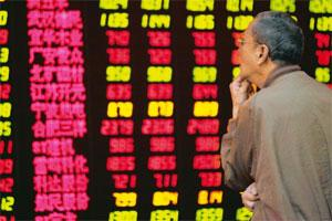 Decoding: A man looks at stock quotes on an electronic screen at a brokerage house in Shanghai, China, on Thursday. Aly Song / Reuters