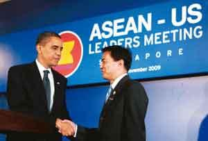 Forging ties: US President Barack Obama shakes hands with Thailand's Prime Minister Abhisit Vejjajiva after the Association of Southeast Asian Nations-US leaders' meeting in Singapore on Sunday. Jim