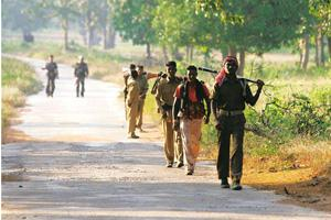 Paving the way: Policemen patrol the Bijapur-Gangalur road in Chhattisgarh. Facing 166 attacks over two-and-a-half years, police helped build the road where government engineers could not. Satish Bate