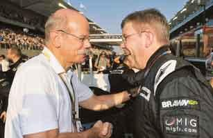 Right formula: Daimler's CEO Dieter Zetsche (left) talks to Brawn Grand Prix team manager Ross Brawn in this 1 November photo. Gero Breloer / AP