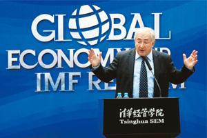 Money talk: Strauss-Kahn at Tsinghua University in Beijing on Monday. He says an undervalued currency yields some advantages, but China needs to look further ahead to long-term stability. Jason Lee /