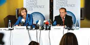Getting ready: Danish climate minister Connie Hedegaard (L) and executive secretary of the United Nations Framework Convention on Climate Change Yvo de Boer at a press conference in Copenhagen on Tue