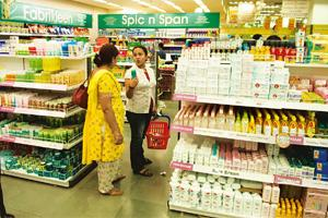 Bigger share: A file photo of people shopping at a Big Bazaar in Noida. Mint