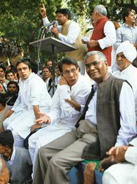 New front: D. Raja of CPI (extreme right) and RLD chief Ajit Singh at the farmers' rally on Thursday. Shabaz Khan/PTI