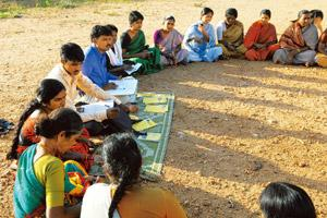 Risky venture: A file photo of area managers conducting a weekly meeting at a village near Mysore. MFIs fear defaults may be higher in the case of home loans because the borrowers would be individuals