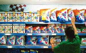 Reviving sales: A store employee arranging HUL's Surf Excel detergent powder in Mumbai. The company has gained market share of around 50 basis points in three categories—soaps, washing powder and ski