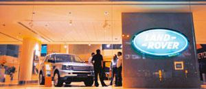 Improving sales: A file photo of a Land Rover SUV at a JLR showroom in Mumbai. Tata Motors second quarter net profit stood at Rs22 crore. Adeel Halim / Bloomberg