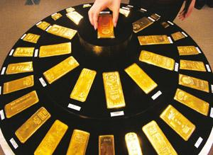Safe haven: Gold has also been sold because the higher dollar makes the precious metal more expensive for holders of other currencies. Hauryoshi Yamaguchi / Bloomberg