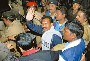 Tightening noose: Former Jharkhand chief minister Madhu Koda being taken away after he was arrested in Ranchi. PTI