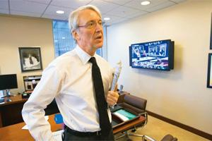 Fantastic environment: A file photo of Dow Jones chief executive Les Hinton in his New York office. Mark Lennihan / AP