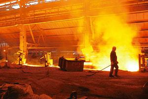 Bumpy road: A file photo of a Tata Steel blast furnace in Jamshedpur. Macquarie's Malik says industrial activity will continue to drive gross domestic product growth in the next two quarters. Santosh