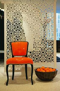 Small wonder: The chair represents three trends: the colour orange, the use of leather and miniaturizing furniture; (below) olive mother-of-pearl vase from DK Home. Madhu Kapparath / Mint