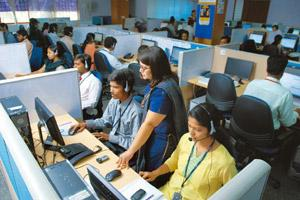 In-house services: A file photo of a TeamLease Services call centre in Bangalore. Some US states have legislation that requires public utility companies to locate their customer call centres within th
