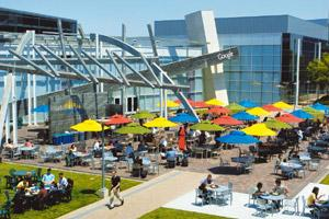 Food for thought: Google employees gather for lunch in the courtyard of the firm's headquarters in Mountain View, California. The Web giant's cafes offer the best of the world's cuisine to its employe