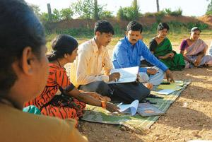 New code: A file photo of area managers at a weekly meeting with borrowers in a village near Mysore. Microfinance firms have decided not to offer above Rs50,000 to any single borrower to avoid loan lo