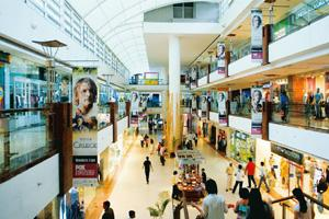 Positive signals: A mall in New Delhi. Shoppers are moving back, giving developers some reason to cheer after growth shrank in the meltdown. Ramesh Pathania / Mint
