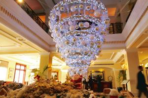 Eco touch: Instead of a 'live' cut tree that will get thrown out next month, the Imperial Hotel in Delhi has installed an inverted 'tree' made of dried foliage, baubles and fairy lights, designed by C