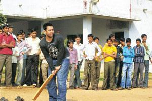 Hit or miss?: Aamir Khan plays cricket with students in Palanpur, Gujarat, at a tour to promote 3 Idiots. PTI