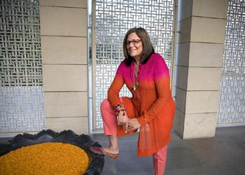 Much like the bright pink Anamika Khanna kurti she is donning in the picture, almost 40% of Mallis' wardrobe is resort wear by Indian designers. Madhu Kapparath / Mint