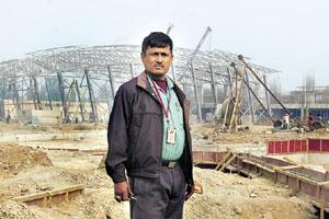 Labour pains: Mahanagar Asangthit Mazdoor Union's Rudra Kakoti outside the Games Village. Unions, struggling to sensitize workers about their rights, focus on construction sites. Ramesh Pathania / Min