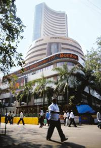 New schedule: People walking in front of BSE building in Mumbai on Monday. Though the markets have advanced the opening trade by almost an hour, banks have not made any change in business hours. Sajja