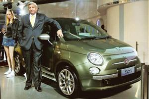 Concept play: Rajeev Kapoor, president and CEO of Fiat India, with the limited edition Fiat 500 at the 10th Auto Expo in New Delhi. Pankaj Nangia / Bloomberg